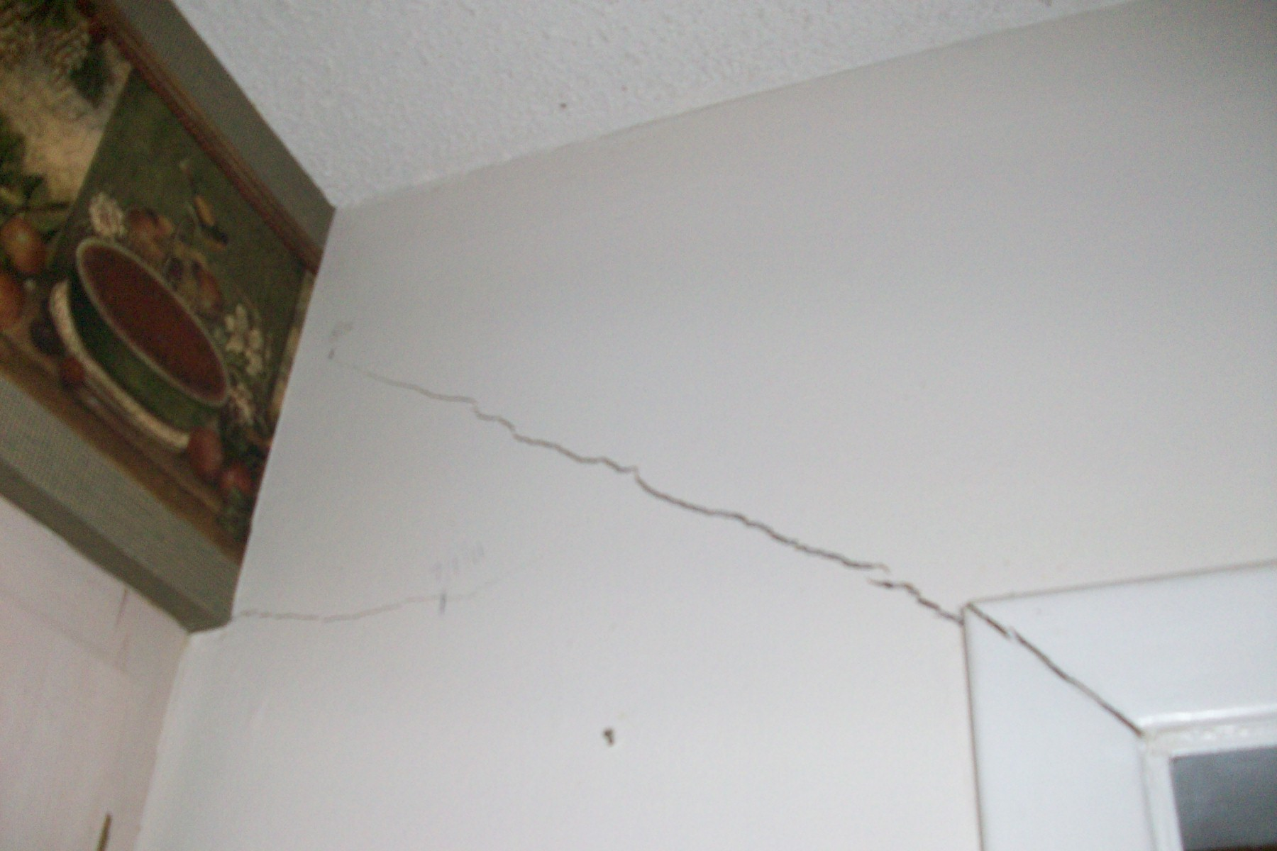 More cracks over the door. Florida sinkhole buyer.
