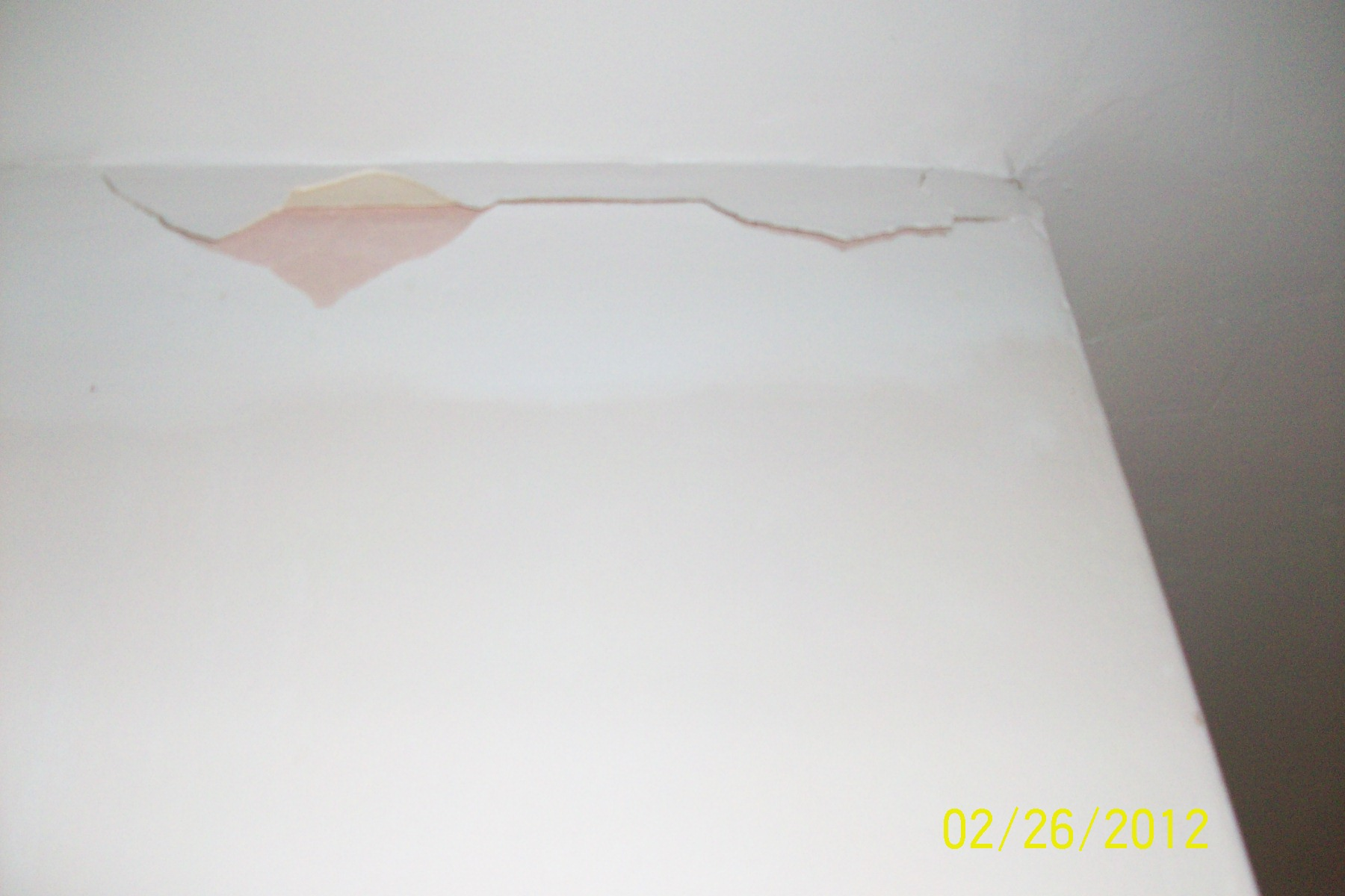 Cracks in plaster by ceiling sinkhole Orlando